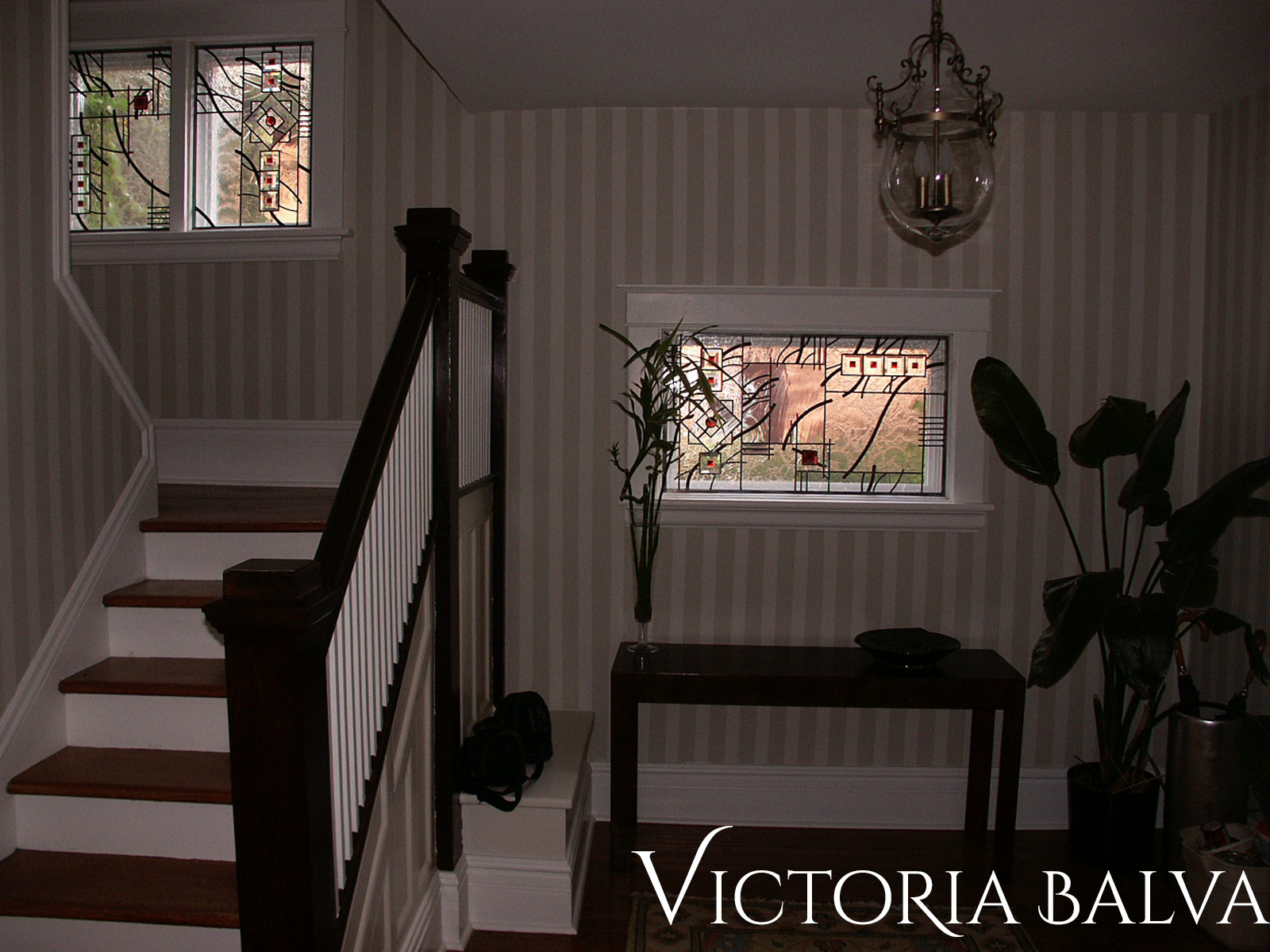 Contemporary innovative stained, beveled and leaded glass foyer hallway and staircase windows with jewels and beveled glass