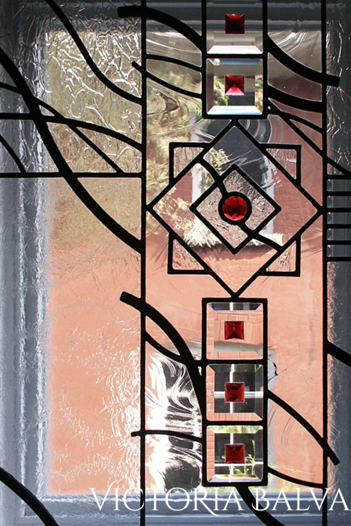 Clear textured glass, bevelled glass geometric art line design. Contemporary abstract window with bevelled glass and pink jewels