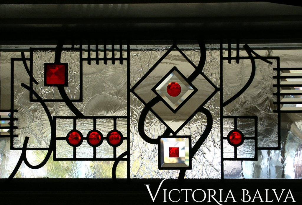 Modern abstract stained and leaded glass transom window with clear bevelled glass, textured art glass and red stained glass jewels
