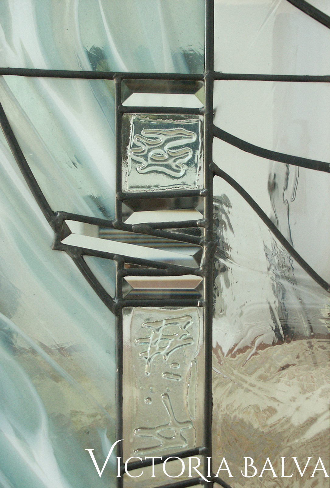 Stained and leaded glass interior door lights with fused glass elements
