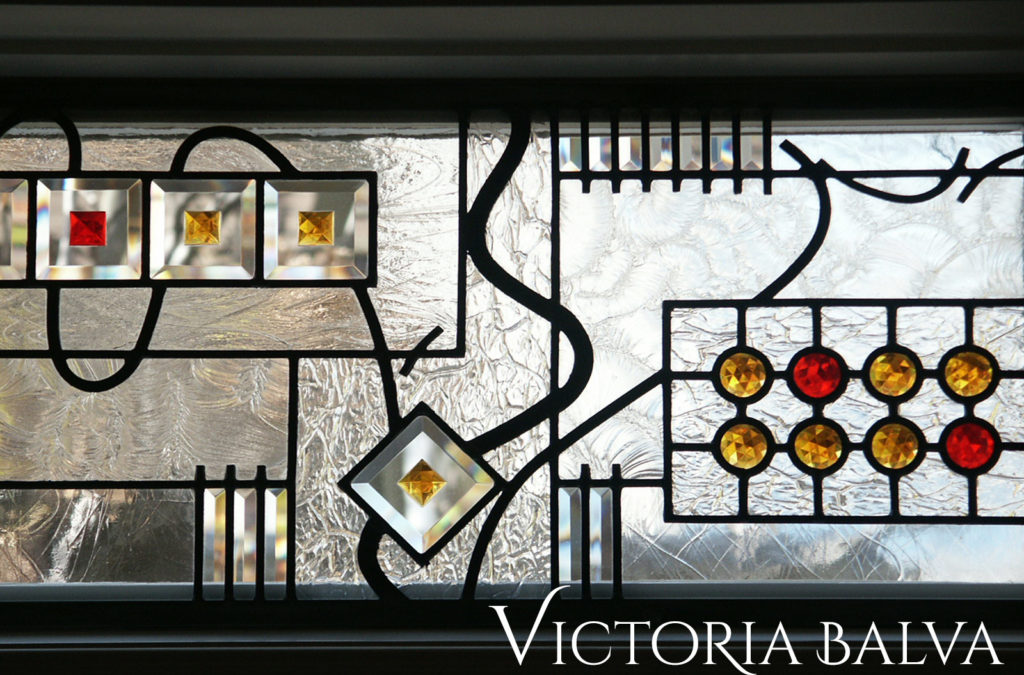 Simple geometric stained and leaded glass design for the transom windows of custom built residence in Forest Hill Toronto