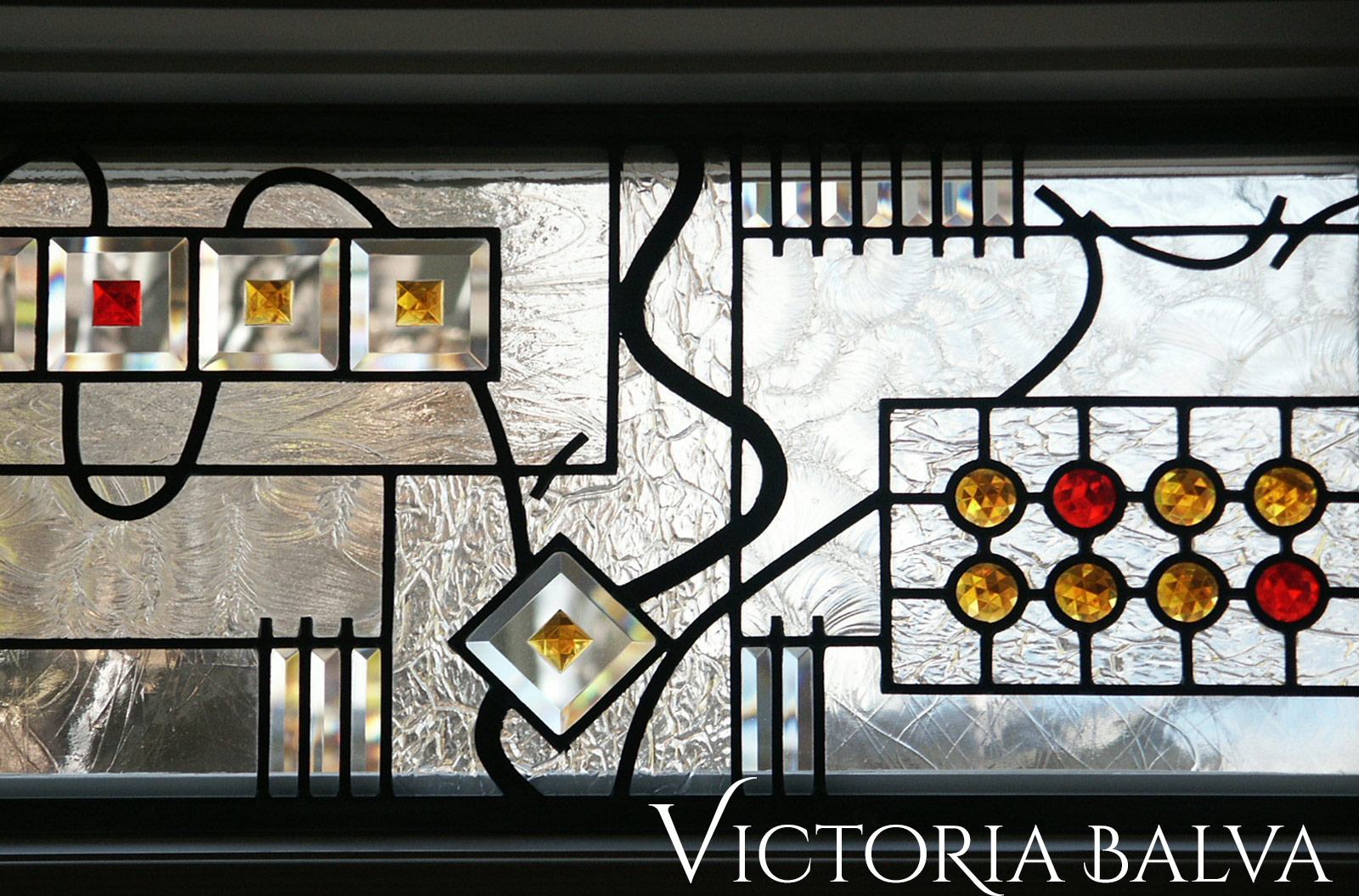 Stained and leaded glass transom windows with jewels and bevelled glass for family room