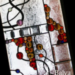 Modern stained glass hanging panel with coloured glass nuggets and bevelled glass for a modern living room
