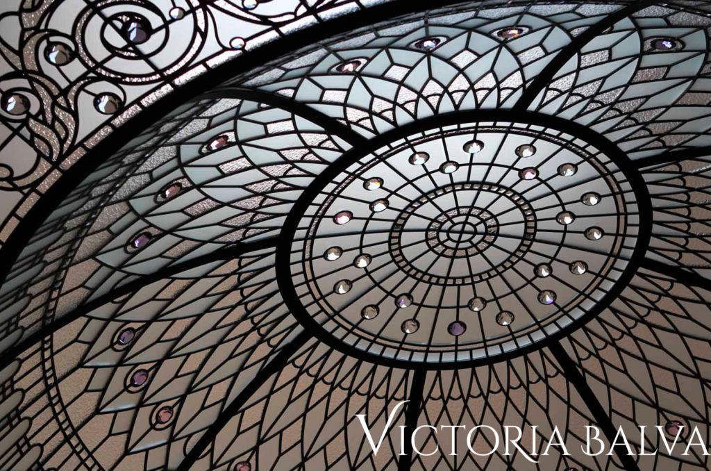 Stained glass dome with clear textured glass and crystal pale lilac jewels with acanthus leaves border ornaments