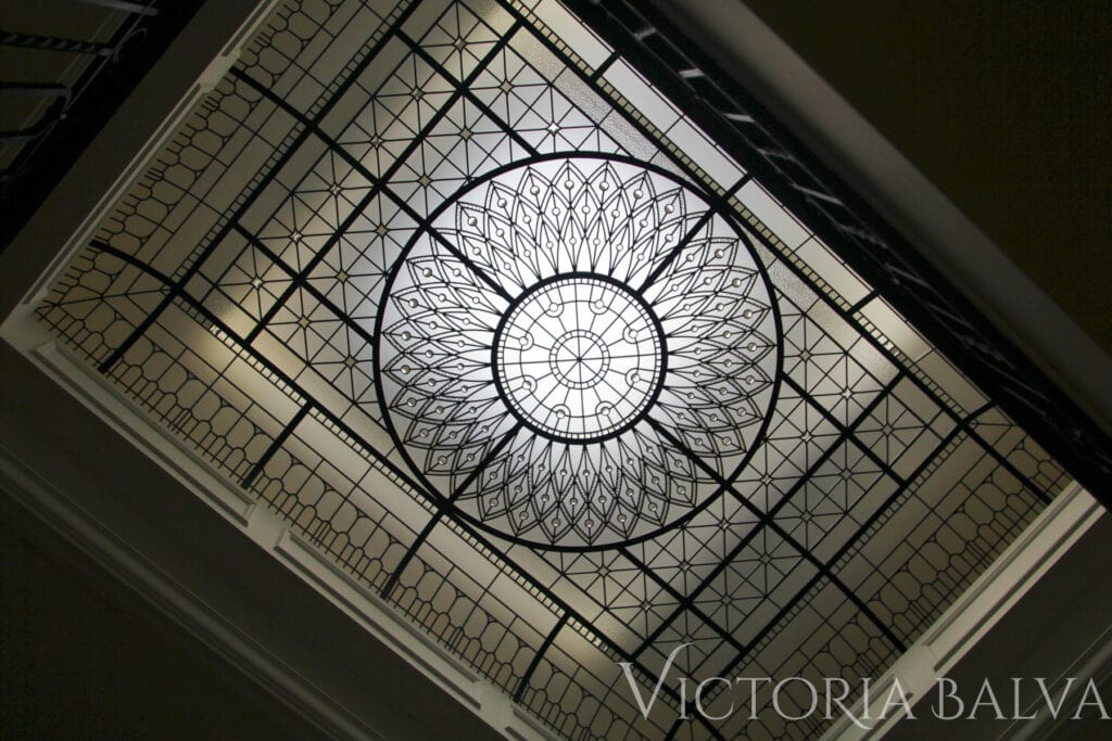 Barrel vault glass ceiling in transitional style with crystal jewels and bevelled glass accents for a custom built luxury house in Toronto