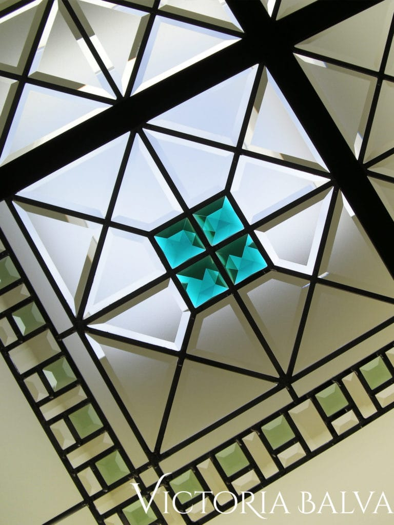 Emerald stained glass jewels and coloured bevelled glass in stained glass art