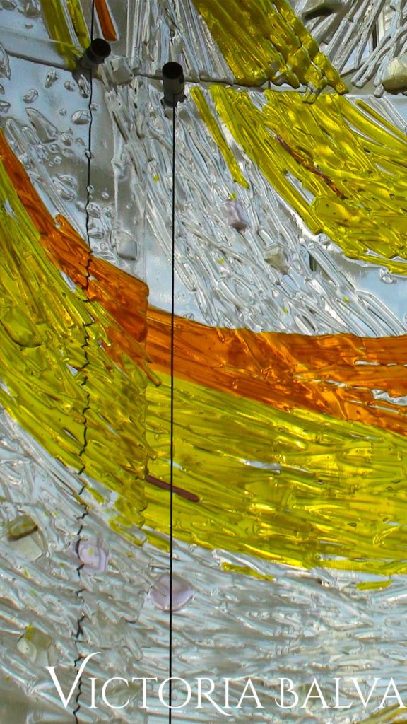 Large scale kiln cast glass mural texture in yellow and gold