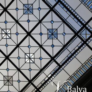 Beveled stained and leaded glass skylight ceiling with clear and blue bevellled glass in classic geometric simple design for a luxury custom built residence