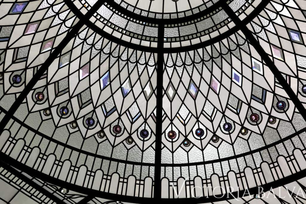 Delicate elusive colours stained and leaded glass domed ceiling lay light for a double height entrance foyer