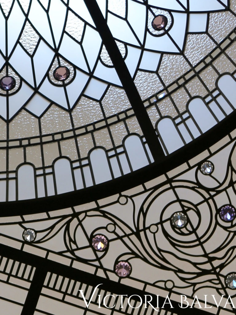 Beautiful intricate ornament around leaded glass dome with crystal jewels and clear bevelled and acid etched glass, spectrum granite