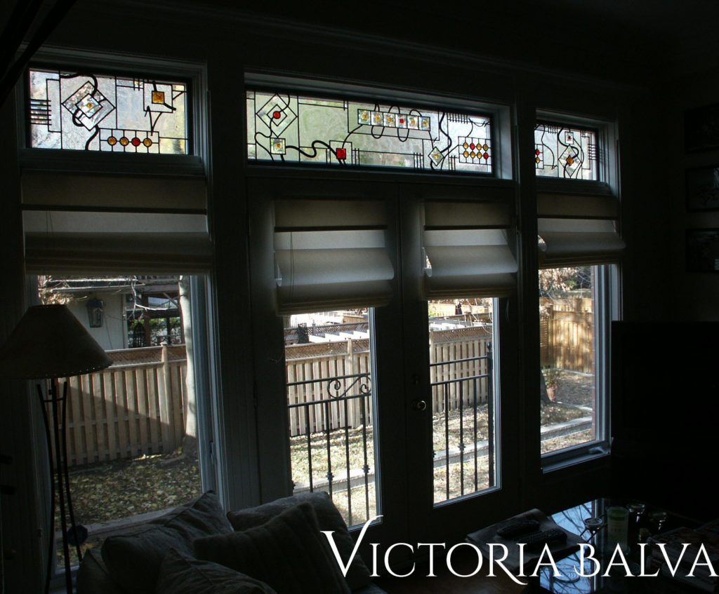 Contemporary design stained and leaded glass windows for a living rooom of a custom built residence in Forest Hill