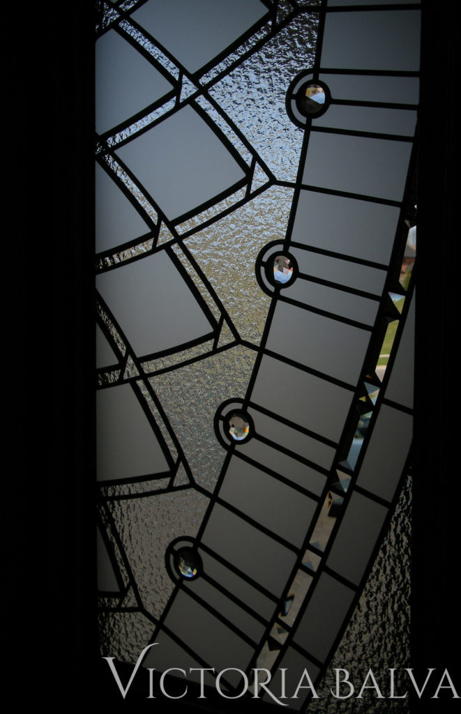 Staircase window with stained and leaded glass