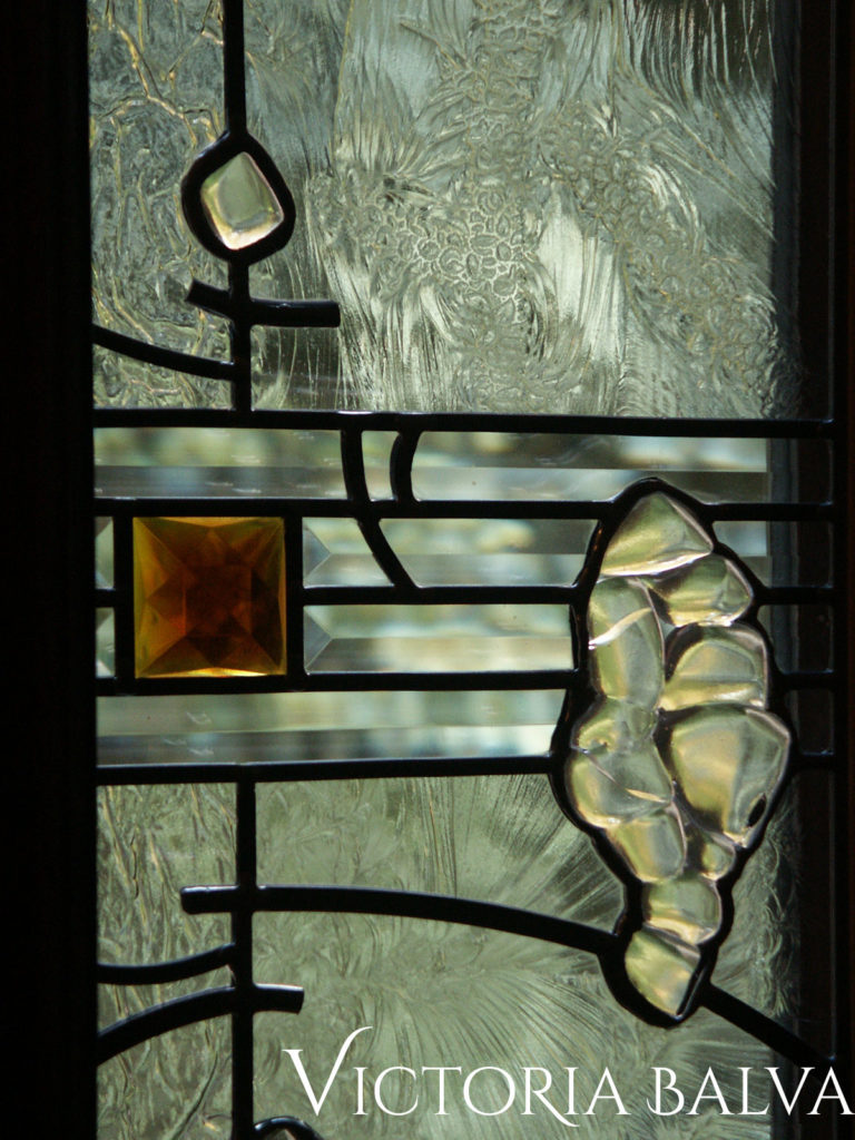 Fused glass, bevelled glass, large amber stained glass jewel in modern design stained glass window
