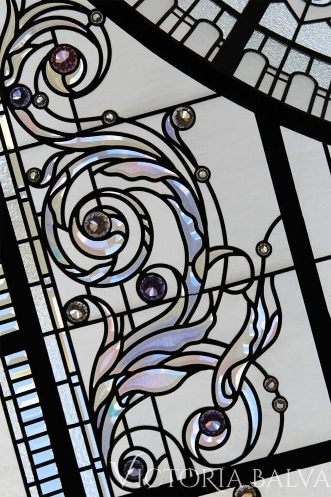 Custom hand beveled acanthus scroll with delicate colour shift and crystal jewels