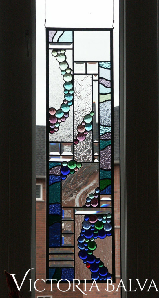 Contemporary abstract stained and leaded glass design with clear baroque, bevelled and glass nuggets for the family room in Burlington
