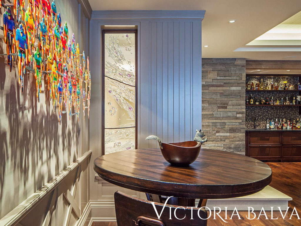 Modern interior with contemporary kiln-formed art glass divider