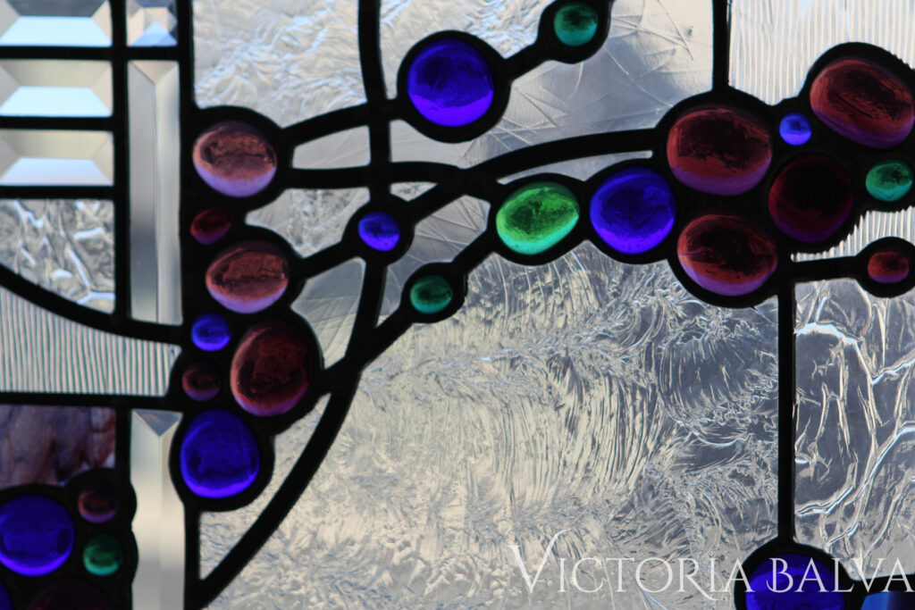 Contemporary stained and leaded glass panel with beveled glass and coloured nuggets and Duncan Glue chip