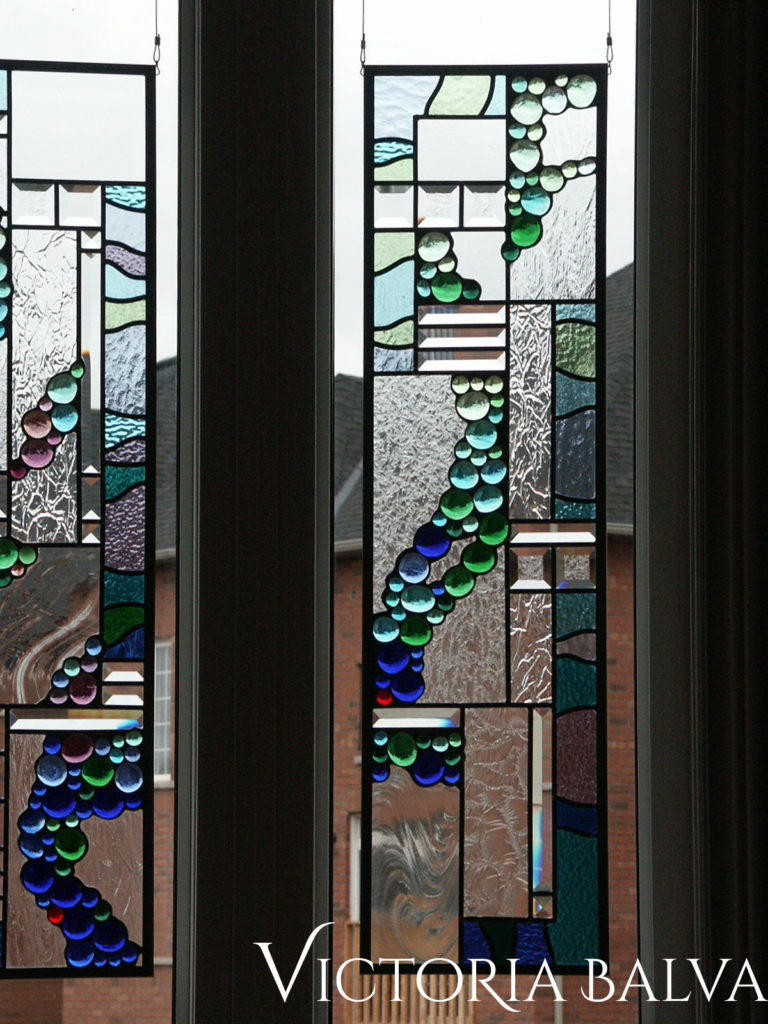 Contemporary abstract stained and leaded glass suspended panels for a family room