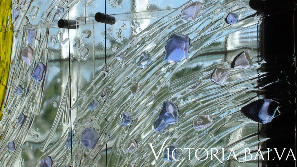 Close up detail of kiln cast art glass mural in clear and lilac