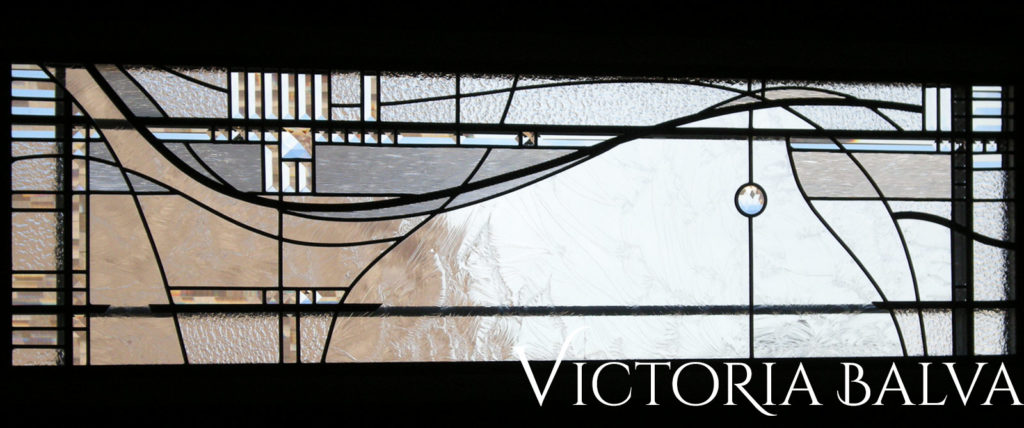 modern art abstract leaded glass window with artistic lines on clear textured art glass