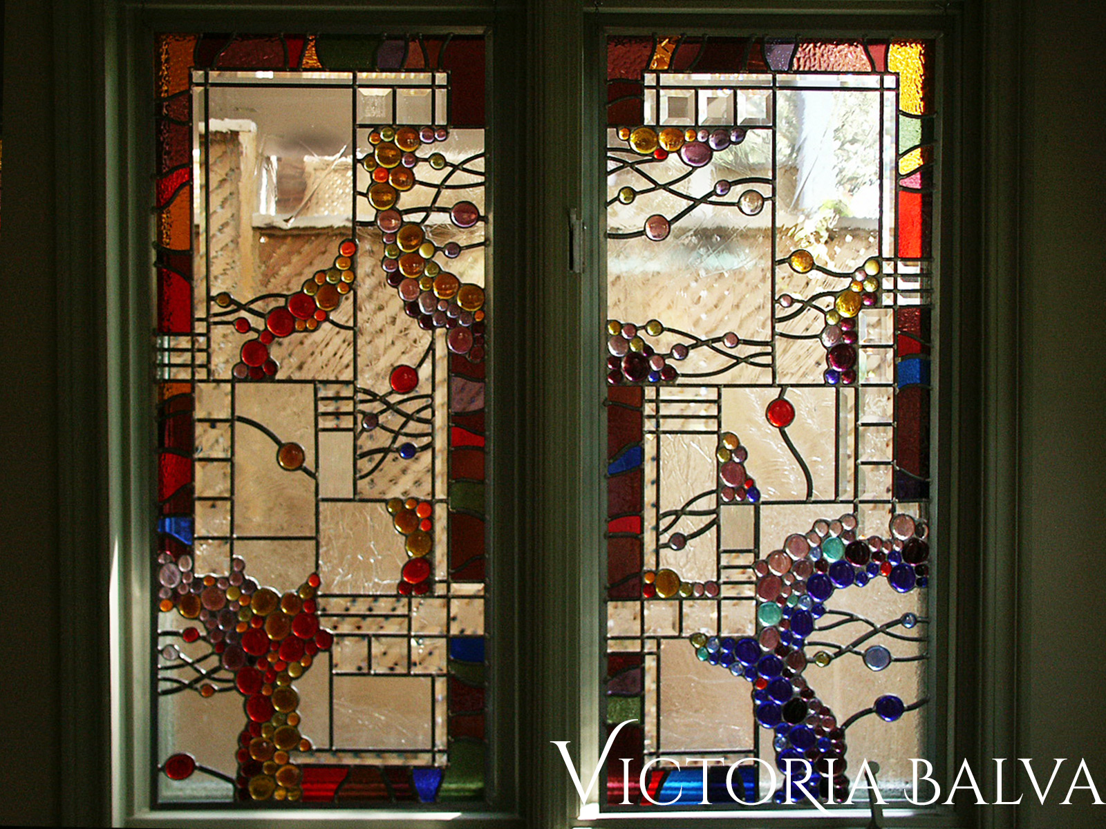Contemporary abstract stained, beveled leaded glass suspended panel with red nuggets and antique mouth blown glass