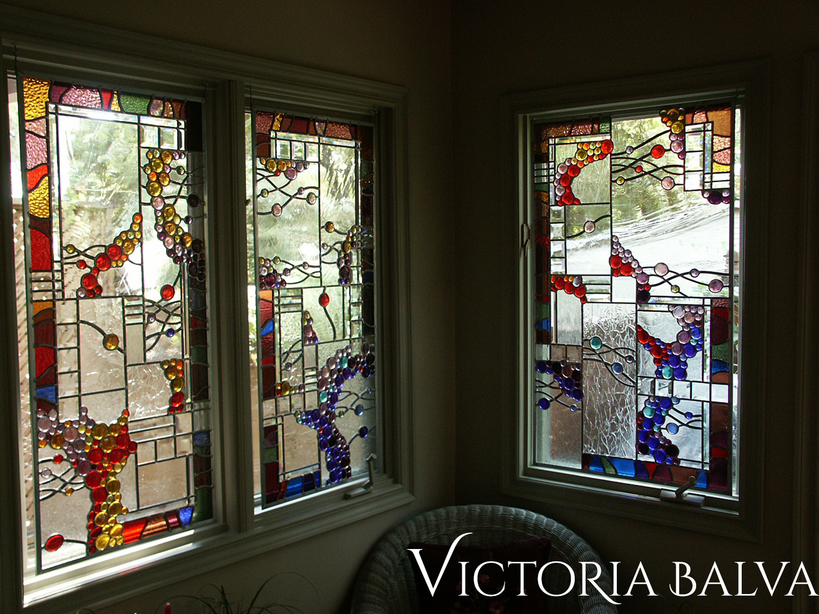 Stained leaded glass suspended panels with nuggets and bevelled glass for solarium room windows after installation