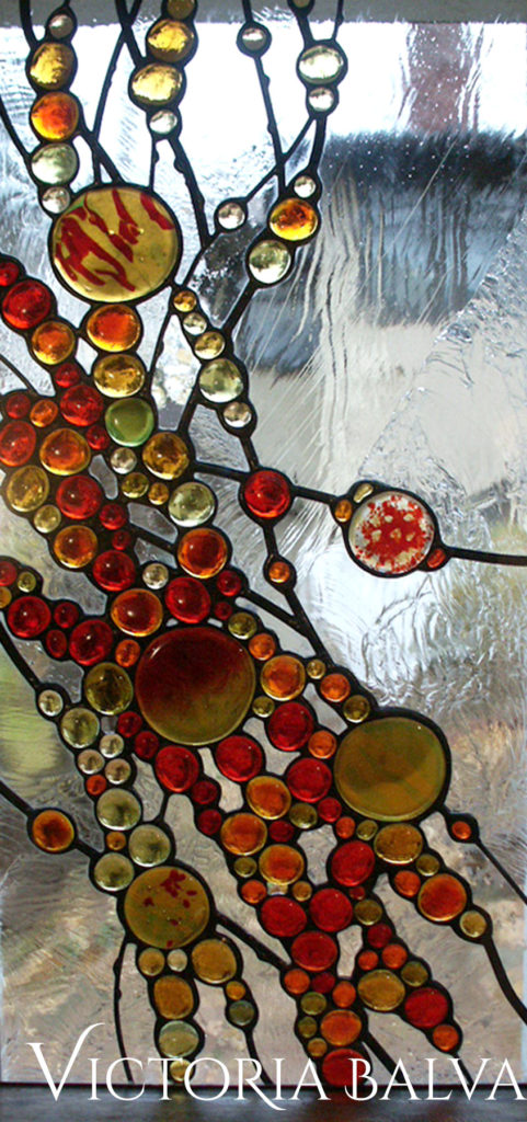 Contemporary art glass window with red glass nuggets, fused flassand clear textured Duncan glass