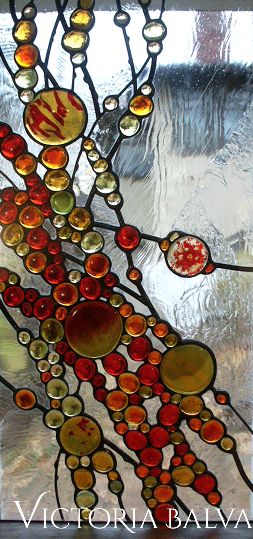 Stained leaded glass window panel in contemporary abstract style by glass artist Victoria Balva