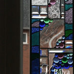 Contemporary abstract stained and leaded glass panels with glass nuggets and bevelled glass