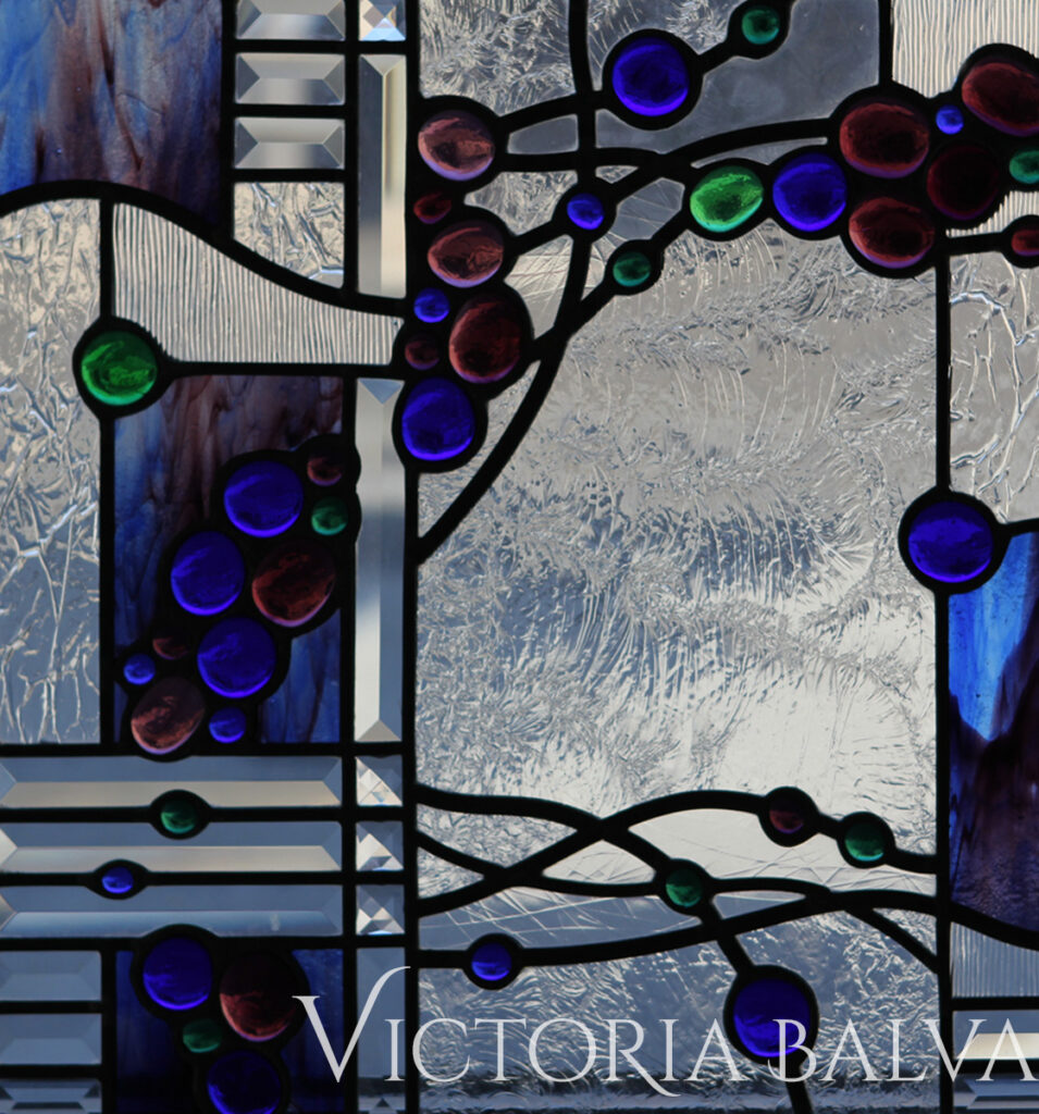 Contemporary abstract stained and leaded glass panel with beveled glass and coloured nuggets