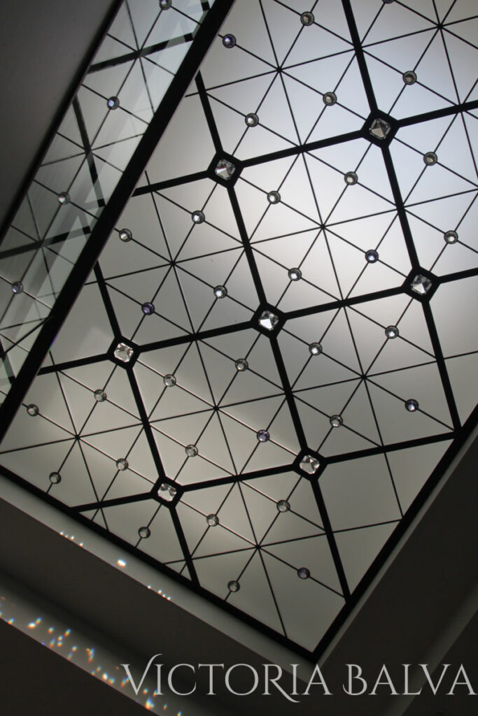 Modern stained and leaded glass ceiling with acid etched glass and crystal jewels