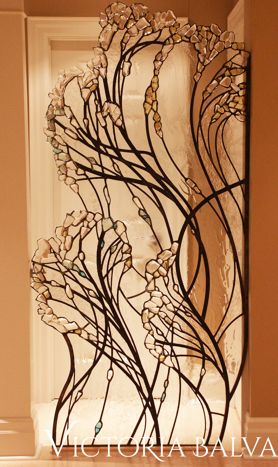 Close up detail of Stained and leaded glass living room divider with kiln formed glass elements