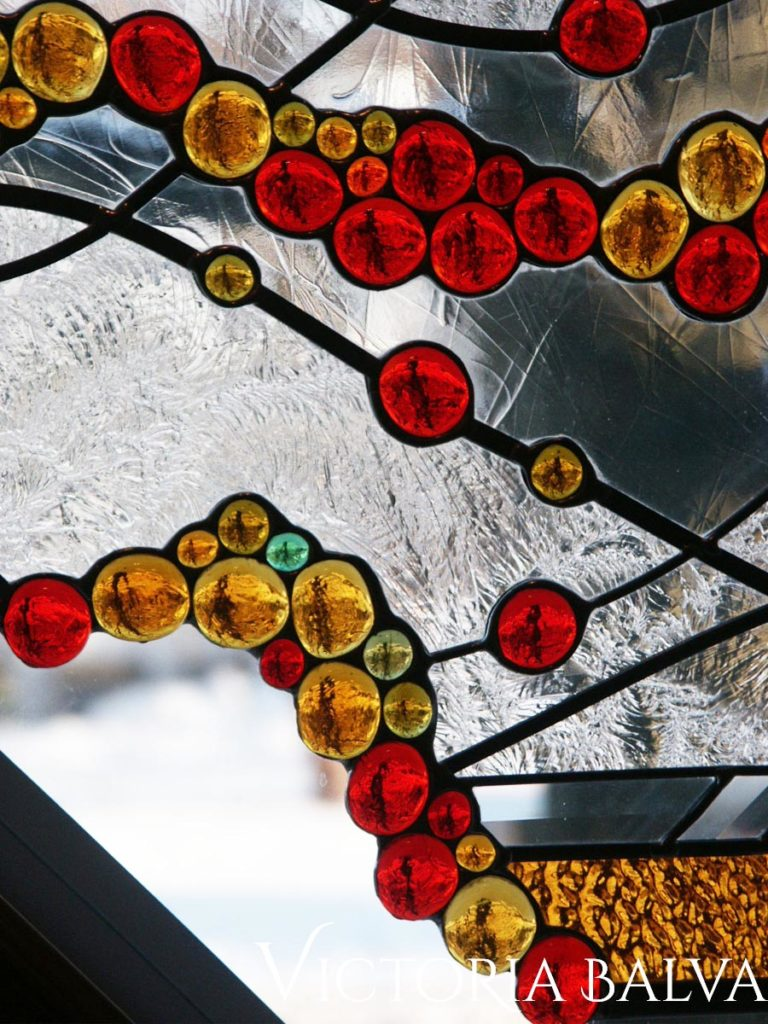 Octagon stained and leaded glass window with open edge glass nuggets and duncan cold textured glass