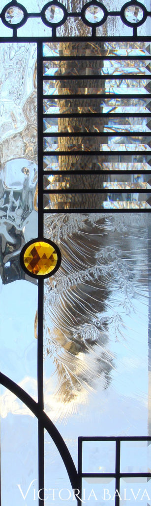 Contemporary stained glass front door with large amber jewel