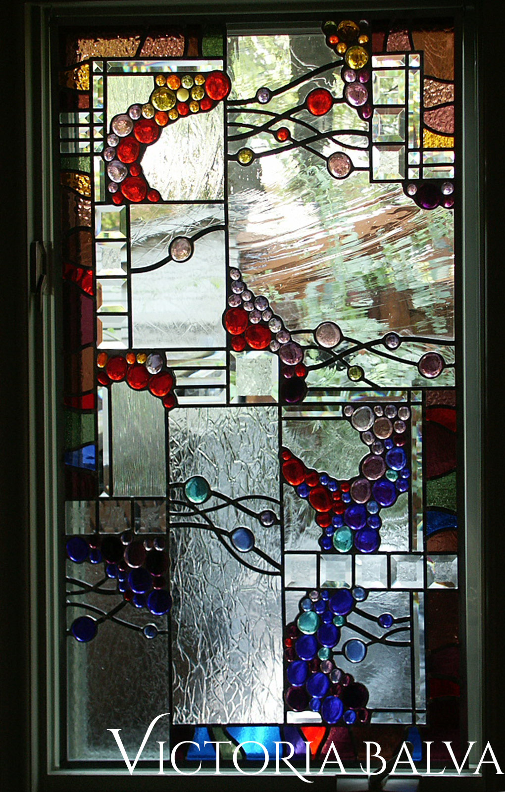 Stained leaded glass suspended panels with nuggets, French antique and bevelled glass for solarium room windows