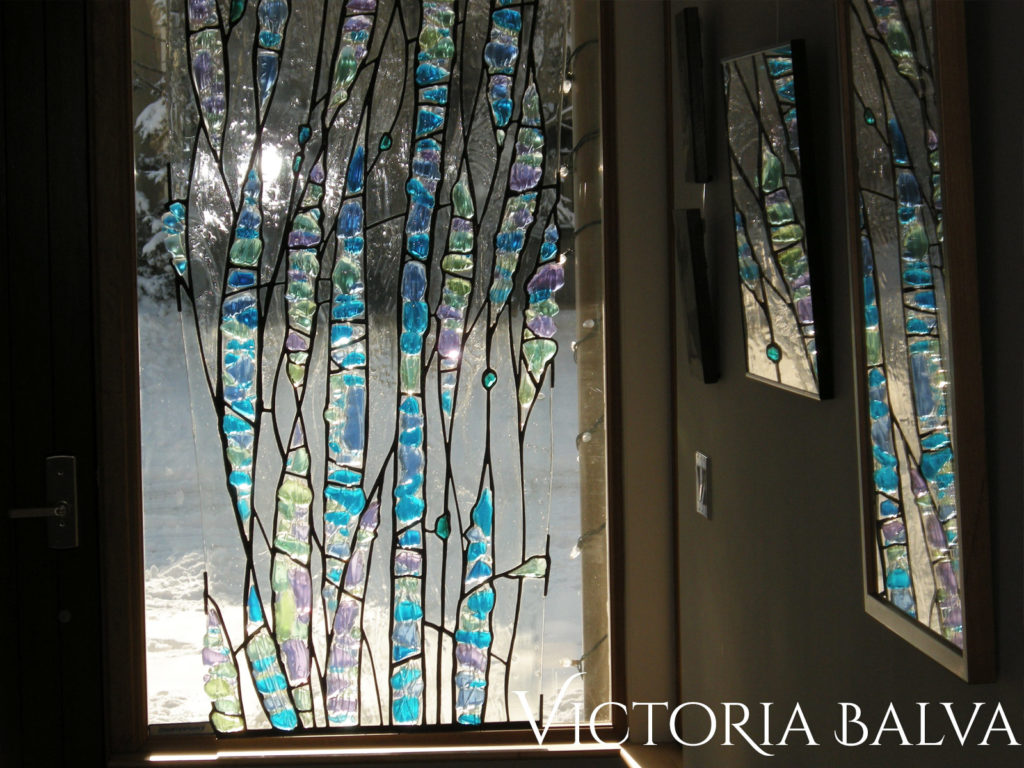 Contemporary stained leaded glass front entrance door window design for the entrance hall of a modern custom built residence