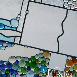 Contemporary stained leaded glass abstract window with coloured glass globes and clear bevelled glass for a bathroom of a custom built architecture