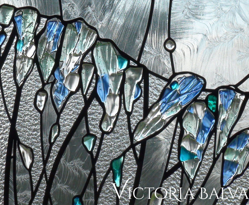 Textured fused glass with accent glass rocks door light detail