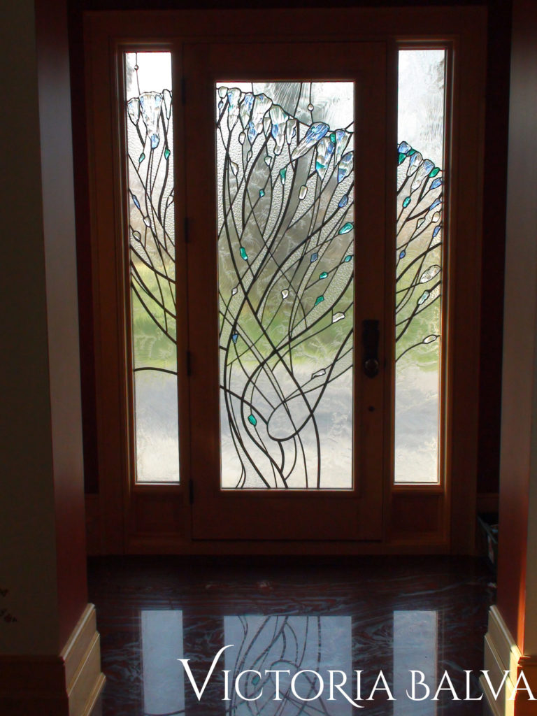 Front entrance door stained leaded glass door system in contemporary style with fused glass elements