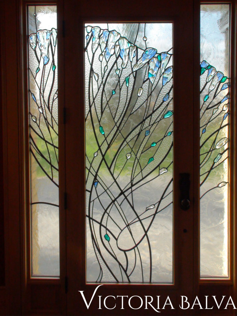 Stained and leaded glass front door system in abstract modern style with fused art glass