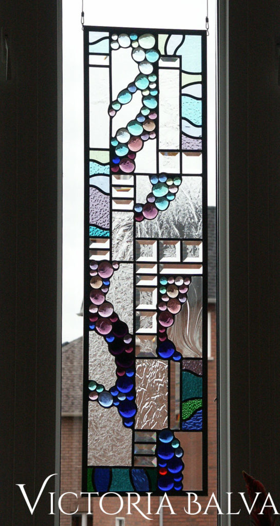 Pale lilac, blue and pale emerald glass nuggets with clear bevelled glass in contemporary style stained and leaded glass panels
