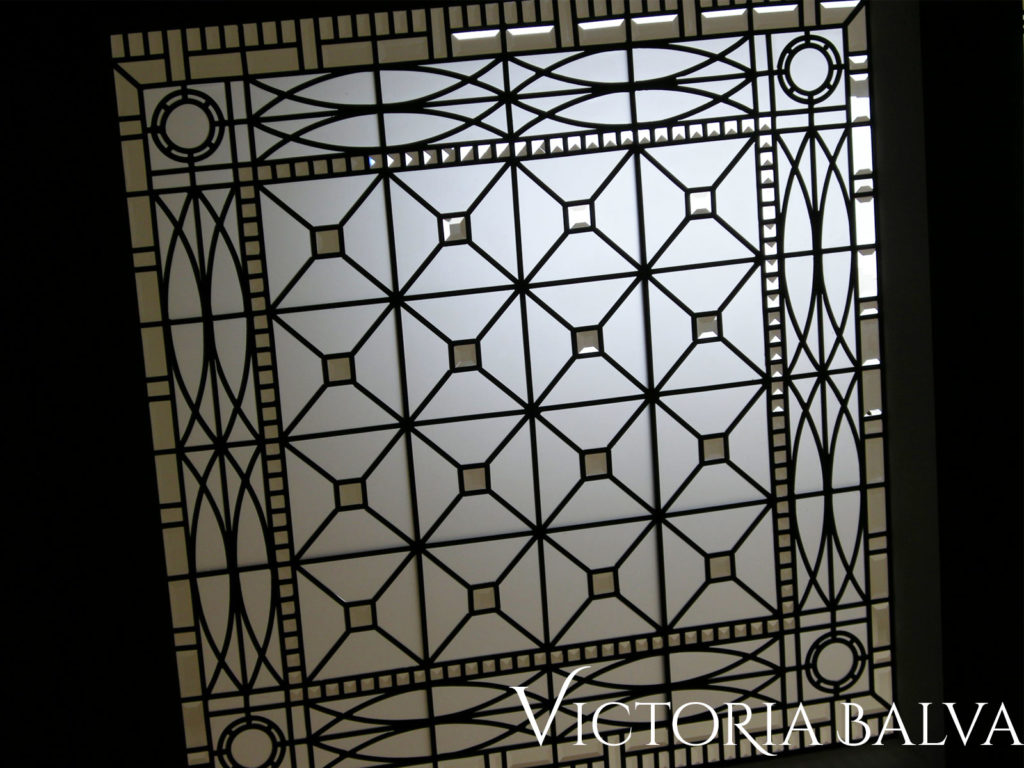 Simple geometric pattern ornamental stained and leaded glass ceiling for custom built house designed by Peter Higgins Architect in Hoggs Hollow