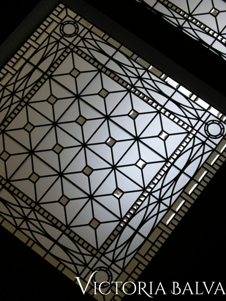 Decorative stained and leaded glass skylight ceiling in simple geomertic style with clear acid etched and beveled glass for a staircase landing of a custom built house designed by Peter Higgins in Hogg's Hollow