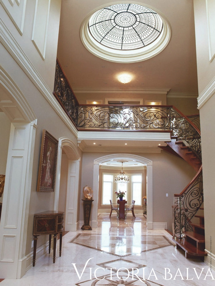 Double-height entrance foyer with stained and leaded glass dome for a custom built home by Nova Custom Builders LTD in Vaughan