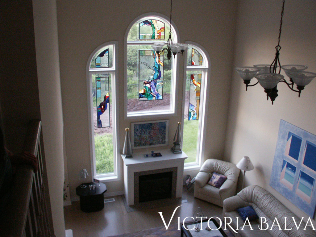 Double height family room with stained and leaded art glass windows set