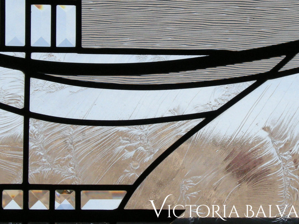 Close up detail of Duncan glue chip textured art glass in modern stained glass window panel