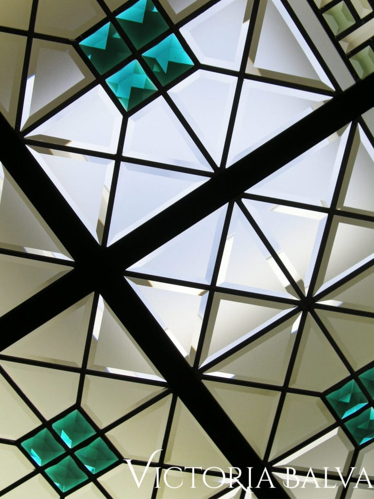 large stained and leaded glass skylight ceiling for a custom built home in Richmond Hill with custom hand bevelled glass and emerald stained glass jewels