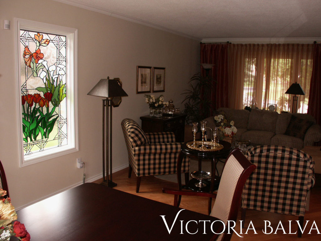 Family room interior with floral design stained and leaded glass window