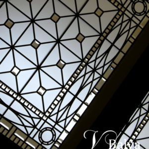 decorative stained and leaded glass skylight ceiling in simple geometric style with clear acid etched glass and bevelled glass