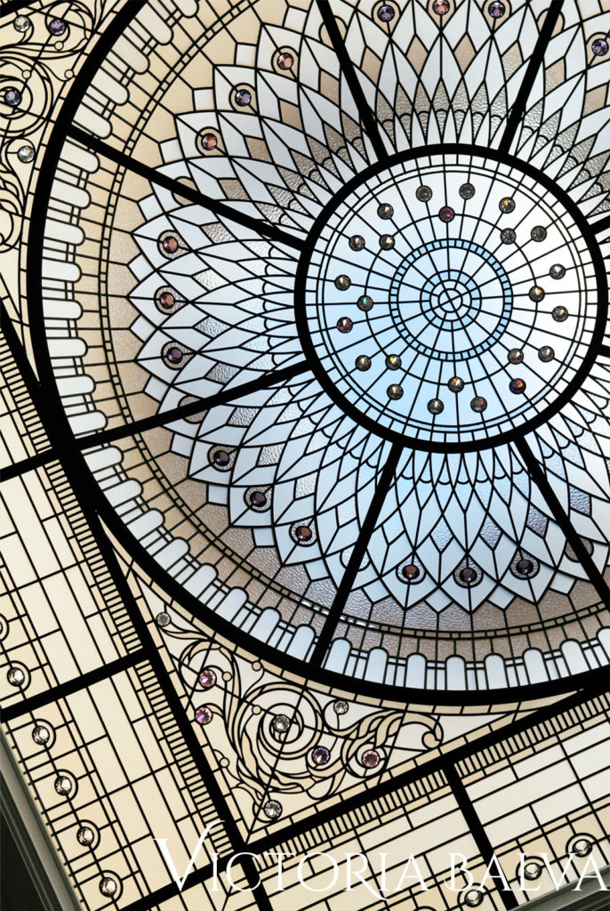 Tiffany stained glass dome skylight with crystal jewels inspired by the Plaza Hotel in New York